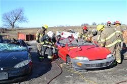 Firefighters Practicing on a Car During Extrication Training